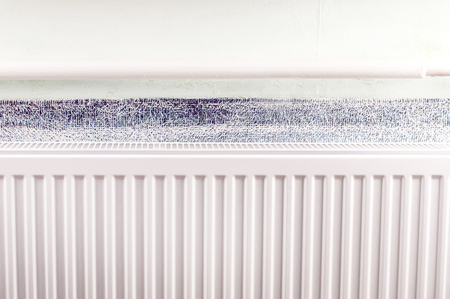 attached: Aluminum radiator of white color attached to the wall Stock Photo