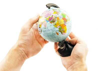 extent: Little political globe in the hands on a white background