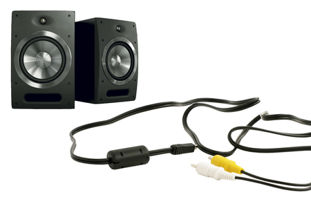 decibels: Music speakers and cables on a white background
