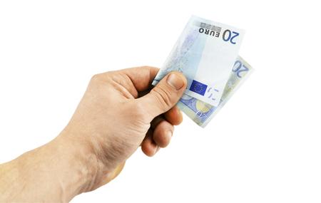 Banknote in denomination of 20 euro in  hand on a white background Standard-Bild