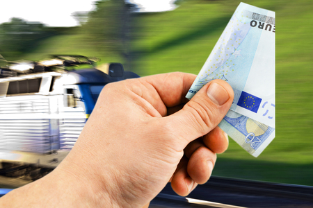 cross ties: The euro in his hand on a background of train under the open sky Stock Photo