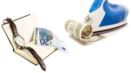 write us: Utyug the dollar and the euro bookmark wristwatches on a white background Stock Photo
