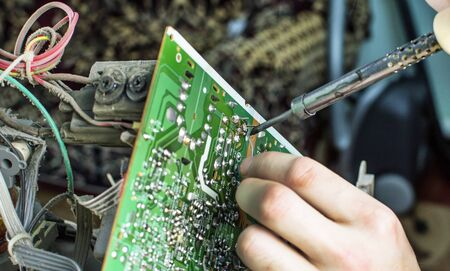 microcircuit: The process of soldering microcircuit TV using a soldering iron Stock Photo