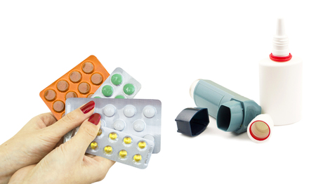 assign: Other drugs to treat asthma and pills in hand on a white background
