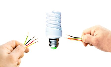 fluorescent lamp: Various wires in his hand and fluorescent lamp on a white background