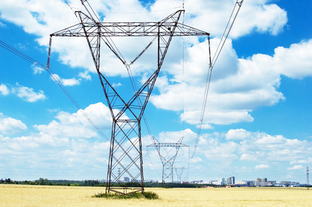 against the current: Power line that goes to the city on a background of blue sky