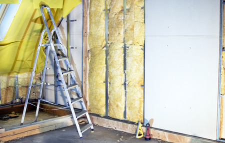 Installation  walls  with plasterboard and mineral wool for thermal insulation Фото со стока