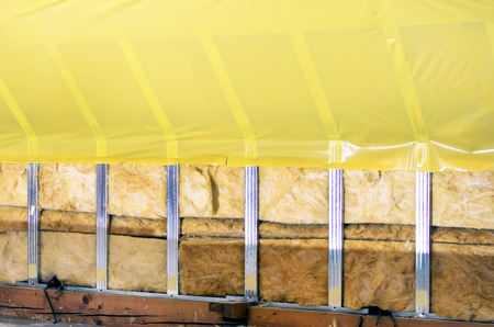 polyethylene: Texture - attic when installing waterproofing of yellow polyethylene films