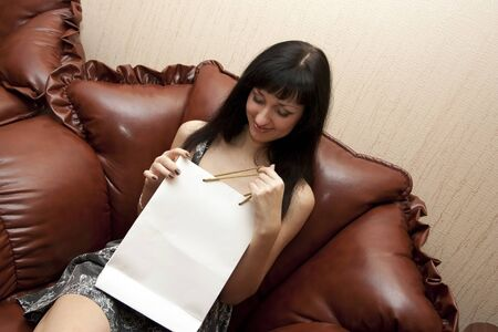 obtaining: The woman with gift packets on a leather seat