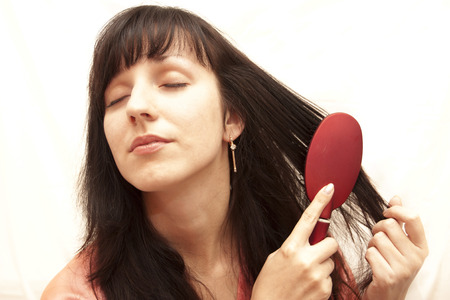 The woman doing a coiffure on a white background