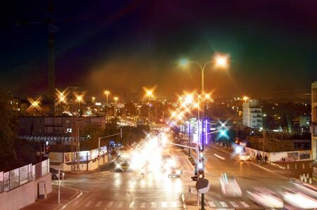 Night view of city streets and roads with cars Stock Photo