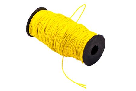 Hank of yellow nylon thread on a white background