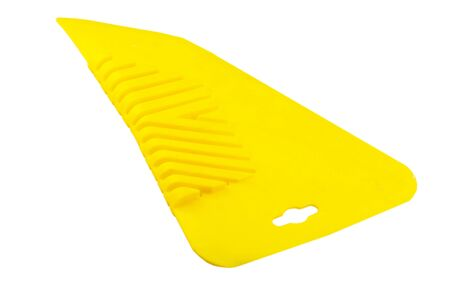 Yellow Spatula for gluing wallpaper on a white background
