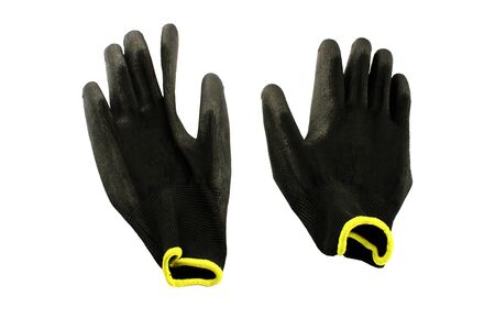 Black gloves for repair work on a white background