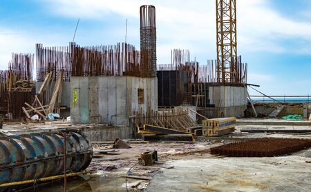 The construction of the foundation and concrete rebar against a background of blue sky