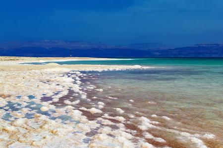 Dead Sea of salt on coast on a background of mountains