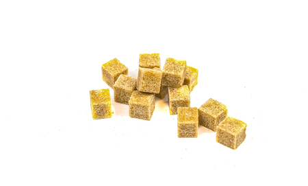 Pieces of cane sugar in the form of cubes on a white background