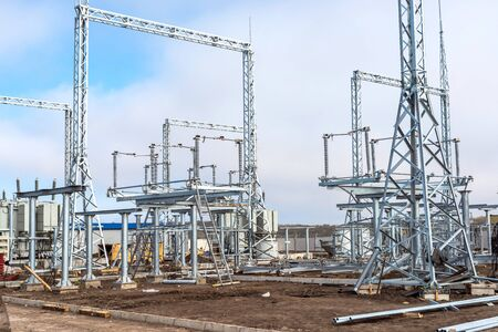 Construction of a new electrical substation from various elements of high-voltage equipment 스톡 콘텐츠