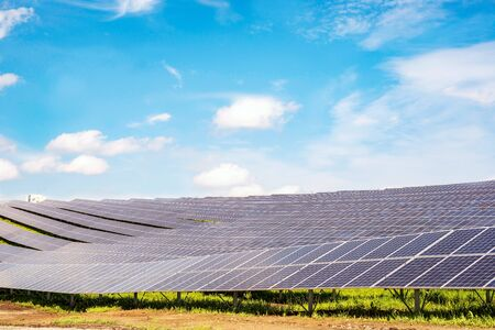 Rows of sections of solar panels on steep hills fields on sky background