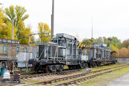 Mobile High Voltage Transformer on Railway Attached to Locomotive Stock Photo