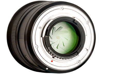 back of a photo lens with a visible aperture on a white background