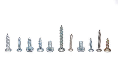 Metal screws and bolts of different types on a white background Standard-Bild