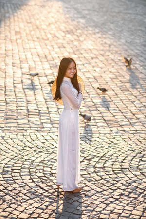 Vietnamese girl dressed Ao Dai white dress. Vietnamese traditional dress. Stock Photo
