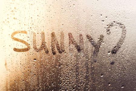 the inscription on the sweaty glass Sunny