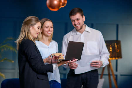 Young caucasian couple during meeting with realtor, interior designer, decorator.