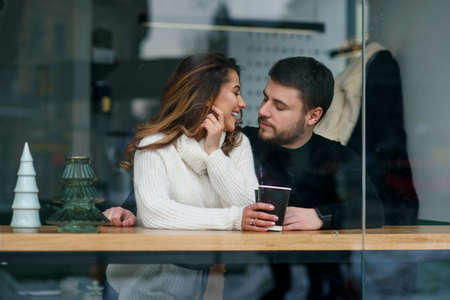 Beautiful caucasian couple in love drink coffee at cafe. Love and romantic concept. Stockfoto