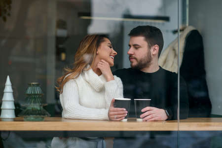Beautiful caucasian couple in love drink coffee at cafe. Love and romantic concept. Stockfoto - 132229391