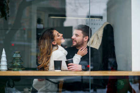 Beautiful caucasian couple in love drink coffee at cafe. Love and romantic concept. Stockfoto - 132229394
