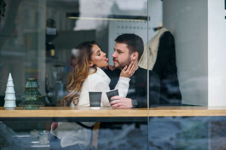 Beautiful caucasian couple in love drink coffee at cafe. Love and romantic concept. Stockfoto - 132229401