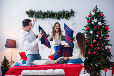 Portrait of happy parents and their daughter having fun at home Stockfoto