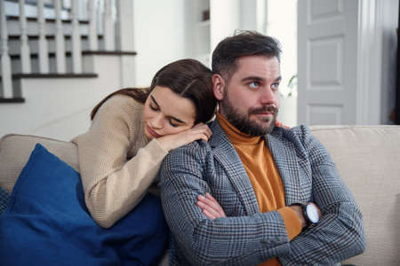 Attractive woman apologizing to frustrated man after quarrel, doubting boyfriend ignore, girlfriend feeling guilty, asking forgive her, begging pardon, admits mistake, regret, couple having problem Imagens