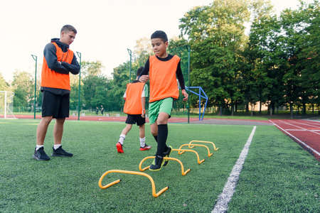 Childrens football players during team training before an important match. Exercises for the youth football team.