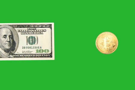 One hundred dollar bill and bitcoin on a white background isolated. Cryptocurrency business concept. Exchange bitcoin cash for a dollar. Free copyspace. 版權商用圖片