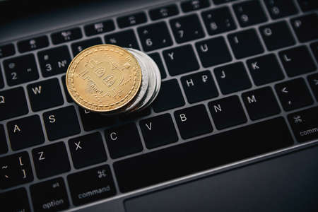 Gold bitcoin on the coins stack, digital money on computer keyboard. Cryptocurrency business concept. Virtual money investment. Cryptocurrency maining.