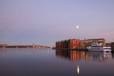 Harbour and a bridge over the bay at nightfall, view fram quay. City of Sundsvall, Sweden photo