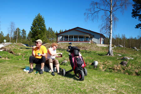A couple taking a break in the game of golf an early spring, Village of Gnarp, Sweden photo