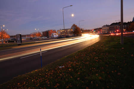 coulorful: Night traffic in autumn with a tendency of stress. City of Sundsvall, Sweden Stock Photo