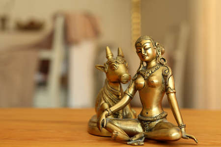 parvati: goddess Parvati contemplates together with a holy cow