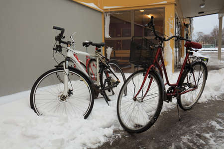 bikes in a snowdrift outside a sports hall an early morning photo