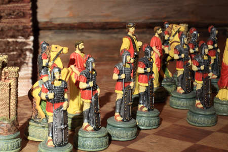 graining: Greek wariors on the chessboard with timbered wall as background Stock Photo