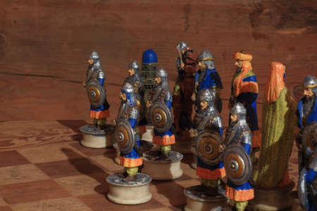 graining: Ottoman wariors on the chessboard with a timbered wall in the background Stock Photo
