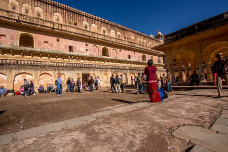 Tourists examines the Amer Fort of Jaipur as the fort is impressive and its decorations are breath takingJaipur, Rajasthan India,  02 2013