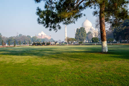 mumtaz: The Taj Mahal mausoleum lit by sunrise beams an early morning, built by Shah Jahan for his love one Mumtaz Mahal Stock Photo
