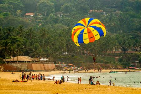 Tourists are para-sailing in the sunny sea side of Calangute BeachCandolim, Goa India   02 2013 Stock Photo - 27028095