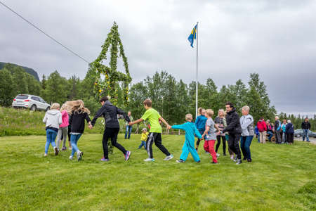 Locals are celebrating midsummer in a small village on its community centre lawnLappland, Kittelfjaell, Sweden  21 June 2013 Stock Photo - 27028071