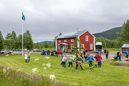 Locals are celebrating midsummer in a small village on its community centre lawnLappland, Kittelfjaell, Sweden  21 June 2013 Stock Photo - 27028073